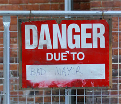 Image of sign saying 'danger due to bad mayor'